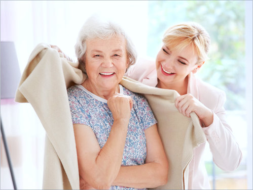 a caregiver woman taking care of an elderly woman