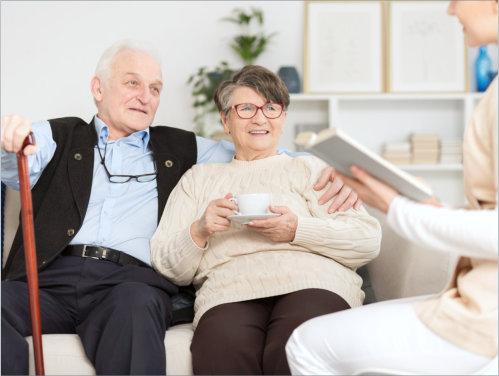 two elderly people sitting