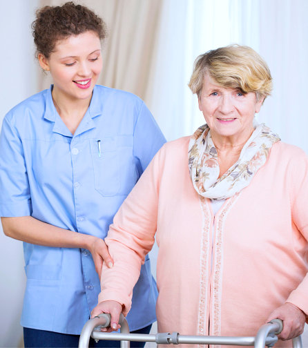 an elderly woman and a caregiver woman